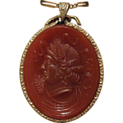 Fine carved Carnelian Cameo set in fourteen karat yellow gold, dated at the early 19th ...