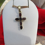 Fourteen karat yellow gold Garnet cross