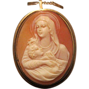 Oval Shell Cameo brooch/pendant depicting the Holy Virgin holding the little Jesus, set in ...