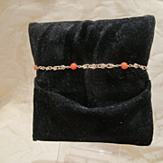 Fourteen karat yellow gold bracelet adorned with tomato red Coral beads