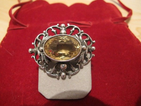 Antique silver brooch with a yellow Topaz in the center, 19th century