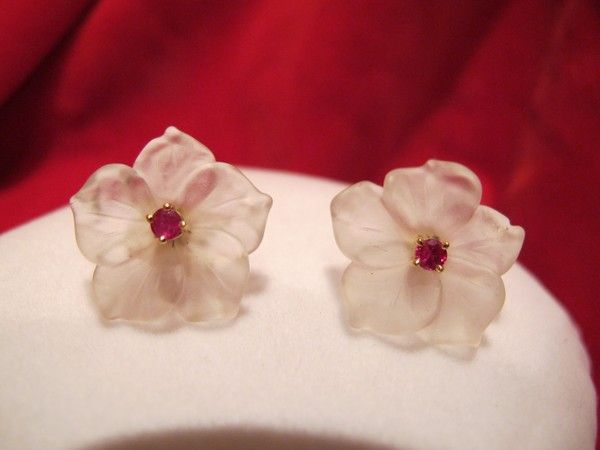 Pair of frosted rock crystal and Ruby studs, eighteen karat yellow gold