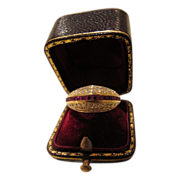 Ruby and diamond ring of bomb� design made of fourteen karat yellow gold.