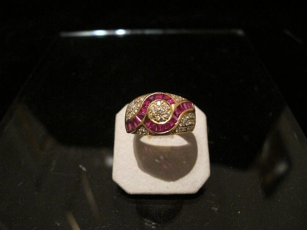 A Ruby and Diamond ring set in fourteen karat yellow gold