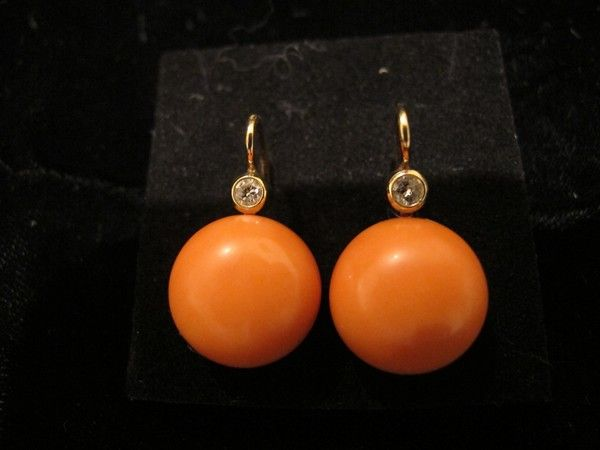 Orange Coral Cabochon and Diamond earrings, set in fourteen karat yellow gold
