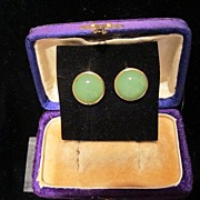Pair of earrings with a Nephrite Cabochon, set in fourteen karat yellow gold