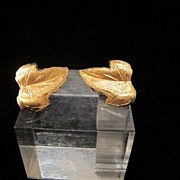 Pair of eighteen karat yellow gold leaf shaped ear clips