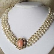 Cultured pearl triple strand necklace with Coral and Diamond clasp