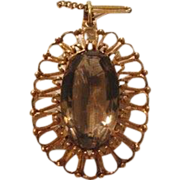A Fourteen karat and Smokey Quartz pendant