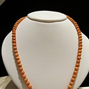 Orange red coral beads necklace with gilded silver closure