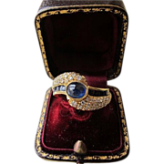 A Diamond and Sapphire ring set in eighteen carat yellow gold