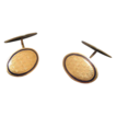 Antique Enamel and fourteen karat yellow gold cuff links, dated at 1920