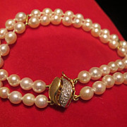 Double strand cultured pearl bracelet with fourteen karat yellow gold and Diamond push clasp,
