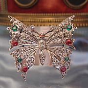 Art Nouveau butterfly silver brooch adorned with glass stones