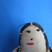 Little beaded native american indian doll