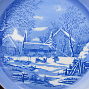 Pretty blue china plate with winter farm scene