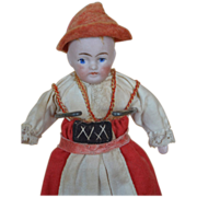 Cute little regional bisque doll