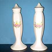 A Pair of  Cream Color Salt & Pepper Shakers with Floral Design