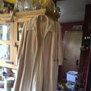 Cream colored vintage coat with two front large pockets