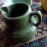 This is a Nelson McCoy buttermilk pitcher. It is jade green