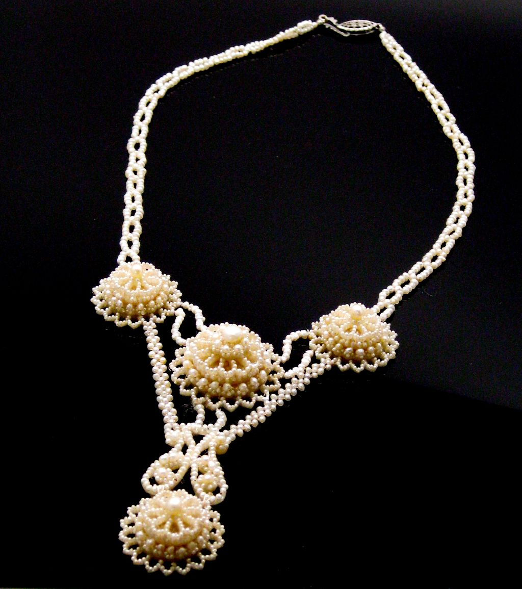 an intricate antique seed pearl necklace from