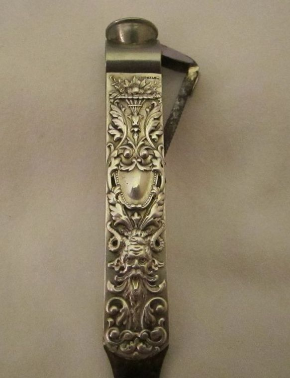 Unusual Art Nouveau Sterling Devil Faced Cigar Cutter Tool