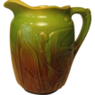 Early Molded Pitcher, Green and Brown Glaze, with Swallowtails and Cattails