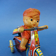 Celluloid & Litho Tin Plate Boy on Tricycle Wind-up Toy