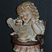 Bisque Figurine of a Child with Dog
