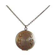 Round Gold Tone Locket
