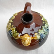 SOLD Peters and  Reed -Art Pottery- Brown Pottery Jug with Grapes Leaves, Lions Heads