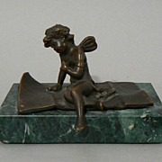 Antique bronze and green marble paperweight cherub signed Ferrand