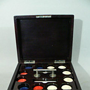 Mahogany cased poker chip set  with Red,  White & Blue chips