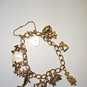 Vintage Ladies 9Ct Gold Charm Bracelet With 12 Charms,Total Weight 27.5 Grams