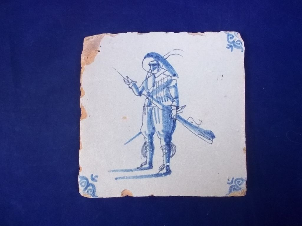 A 17th-century Dutch Handpainted Tile Depicting a Soldier With Musket