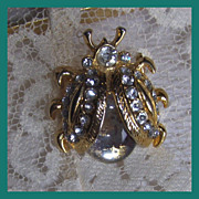 Ornate beetle with rhinestones and  a jelly cabochon