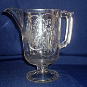 Antique colorless eapg cupid and venus guardian angel milk pitcher