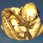 Japanese Netsuke looks like a bread merchant