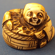 Japanese Netsuke Merchant with a Basket