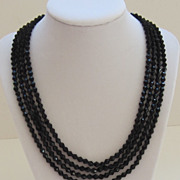 Striking Vintage Black Glass 4 Strand Necklace