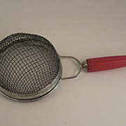 Androck Red Bakelite Stainer with Bullet Handle Vintage Kitchen Utensil