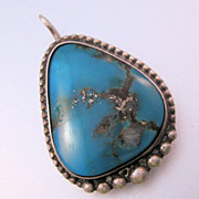 Vintage Native American Turquoise Nugget Sterling Pendant with Silver Vein thru Stone