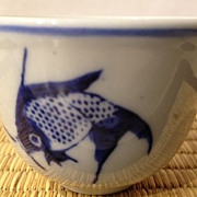 SALE Asian porcelain tea cup - white with blue/fish scene