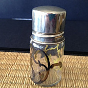 "SALE Bottle with silver lid/clear glass with brown-gold colored scrolls-3"" high"