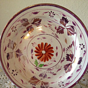 Pink Luster Small Plate w/one orange flower in middle w/green leaves-1850's