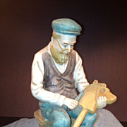 Porcelain Biscuit Figure of toy-maker - German