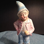 Porcelain Figurine - Man dressed in pink jacket and blue pants & hat