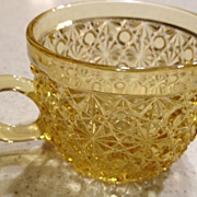"Punch cup w/handle - amber glass ""Daisy & Button"" pattern - antique 2-1/4"" high"