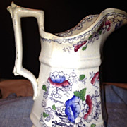 Stoneware Cream Pitcher - Early 1800's - White with Red & Blue Flowers