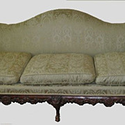 Camel backed sofa with hand carved frame